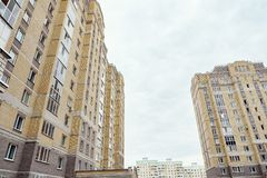 Modern condominium building real etate in city with blue sky.  stock photo