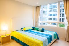 Modern condominium living room and bedroom in condominium. Location at Bangkok stock photography