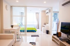 Modern condominium living room and bedroom. Location at Bangkok Thailand stock photography