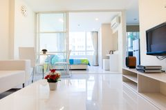 Modern condominium living room and bedroom. Location at Bangkok Thailand royalty free stock images