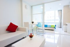 Modern condominium living room and bedroom stock photo