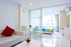 Modern condominium living room and bedroom stock photos