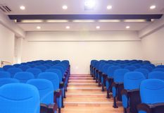 Modern conference room. Shot of modern conference room. Lighten LCD projector and light right before entrance of group of people Stock Image