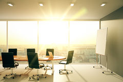 Modern conference room with furniture and city view at sunrise Royalty Free Stock Images