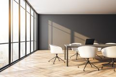 Modern conference room. Interior with panoramic city view, furniture, laptop on desktop and daylight. Toned image. 3D Rendering stock illustration