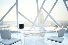 Modern conference room. With laptops on table and abstract windows with New York city view. 3D Rendering Stock Photo