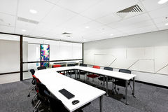 Modern conference room with round white table Stock Images