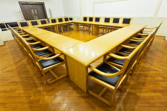 Modern conference room with wooden tables Royalty Free Stock Image