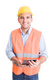 Modern and confident engineer holding tablet Stock Images
