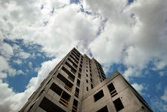 Modern construction. Against the blue sky and clouds Royalty Free Stock Images