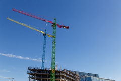 Modern construction cranes in front of blue sky. Modern construction cranes in front of blue sky stock image