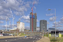 Modern construction site, stratford, london, uk. Image taken of cranes working on a modern construction site with blue sky with clouds in stratford, east london Royalty Free Stock Image