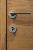 Modern, contemporary satin handle on a door. Modern, contemporary satin handle on a wooden door Stock Image