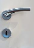 Modern, contemporary satin handle on a door royalty free stock photos