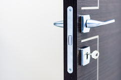 Modern, contemporary satin handle and keyhole. Modern contemporary satin handle and keyhole detail Stock Photo
