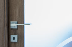 Modern, contemporary satin handle and keyhole detail. Modern contemporary satin handle and keyhole Royalty Free Stock Photos