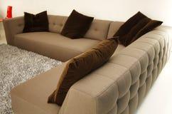 Modern Contemporary Sofa. Mocha Brown Contemporary Sofa Set with big cushions in a Living Room Stock Photos