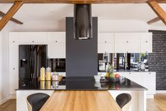Modern contrast color kitchen. With black glossy countertop and white cabinets stock photos