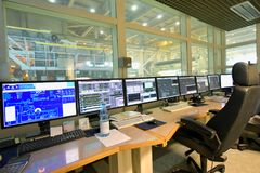 Modern control centre with screens for monitoring and operating. The machines in a paper mill royalty free stock images