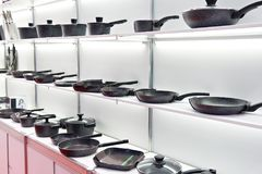 Modern cooking pans in store. Modern cooking pans on the shelves in the store Stock Images