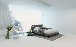 Modern cool bedroom interior overlooking a garden Royalty Free Stock Images