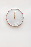 Modern copper and white decorative wall clock Stock Photo