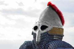 Modern copy of antique metal knight helmet with aventail. Historical medieval costume detail.  Royalty Free Stock Image