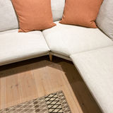 Modern corner sofa with two cushions Stock Photography