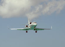 Modern corporate jet landing Stock Photos