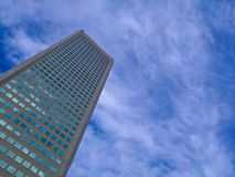 Modern corporate office building with blue sky summer. Modern generic tall business head quarter corporate office building with blue sky summer and the cloud Stock Image