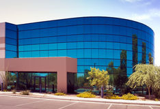 Modern corporate office building entrance. In office park stock photography