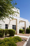 Modern corporate office building entrance. In office park stock photos