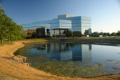 Modern Corporations. A picture of a corporate building across landscaped pond royalty free stock photography