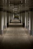 Modern Corridor With Mirrors. Long Modern Corridor With Mirrors Royalty Free Stock Photo