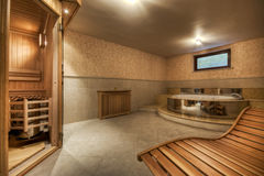 Modern and cosy sauna and jacuzzi. Modern,cosy sauna and jacuzzi in modern house Royalty Free Stock Photo