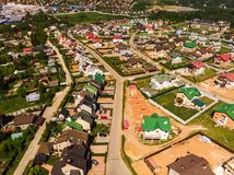 Modern cottage village near Moscow, Russia. aerial survey. View of the cottage village near Moscow from the top, Russia Royalty Free Stock Photo