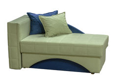 Modern couch. Arranged bed over white background. Colorful  couch Royalty Free Stock Photo