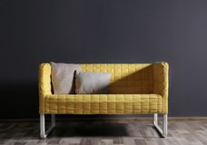 Modern couch on dark background. Modern couch on dark wall background Stock Photography