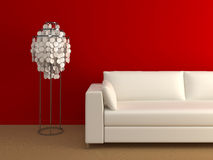 Modern couch and lamp. Near the red wall Royalty Free Stock Photos