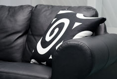 Black couch. Modern leather couch with abstract pillows Stock Photography