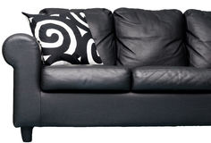 Black couch. Modern leather couch with abstract pillows Stock Image
