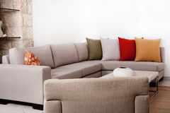 Modern couch withe coloured pillow Stock Images