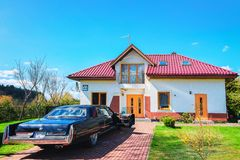 Modern country house and car at courtyard Druskininkai Lithuania. Druskininkai, Lithuania - May 1, 2017: Modern country house and car at small courtyard royalty free stock photography