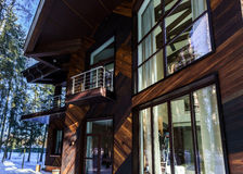 Modern country house equipped  by big fiberglass windows Royalty Free Stock Images