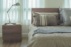 Modern country style bedding and reading lamp Royalty Free Stock Photography