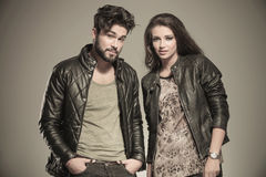 Modern couple in leather clothes standing next to each Royalty Free Stock Photography