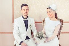 Modern couple in luxurious wedding gowns stock photos