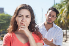 Modern couple with relationship problems in the city. With buildings and street in the background royalty free stock photos