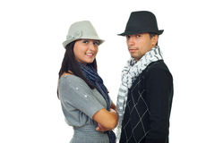 Modern couple wearing hats Royalty Free Stock Photo
