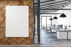 Coworking office with empty poster. Modern coworking office interior with empty poster wall, city view and workplace. Mock up, 3D Rendering royalty free stock photography